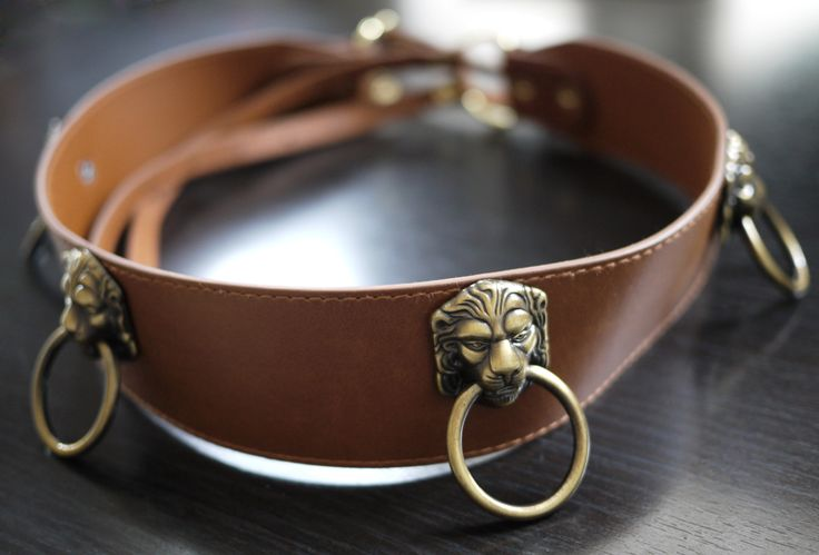 DIY Door Knocker Belt.  And for my equestrian friends - what about the little horse head and rings?  And for goths - a little gargoyle.  My mind is running all the possibilities!