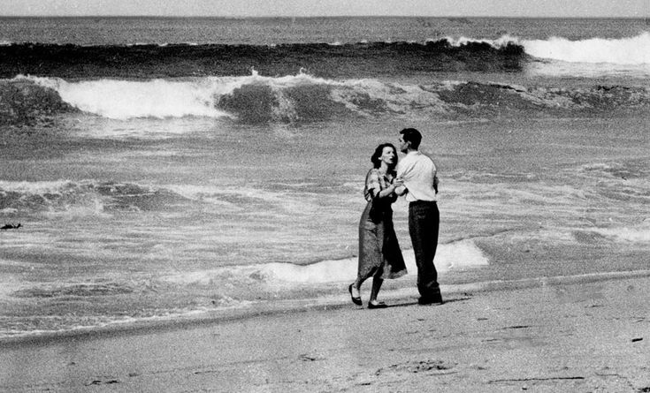 April 2, 1954 A couple is photographed moments after learning that their 19-month-old child had been swept out to sea at Hermosa Beach