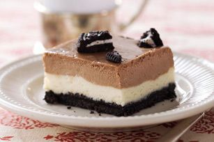 A layered chocolate-OREO cheesecake for a crowd, made even better since it can be made in advance!