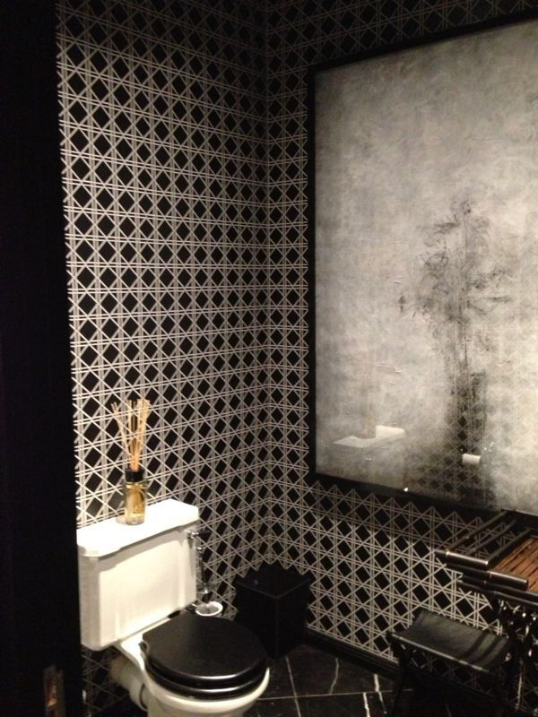 """The """"Basket Weave"""" design creates an exciting buzz in this bathroom yet still gives a sophisticated edginess."""