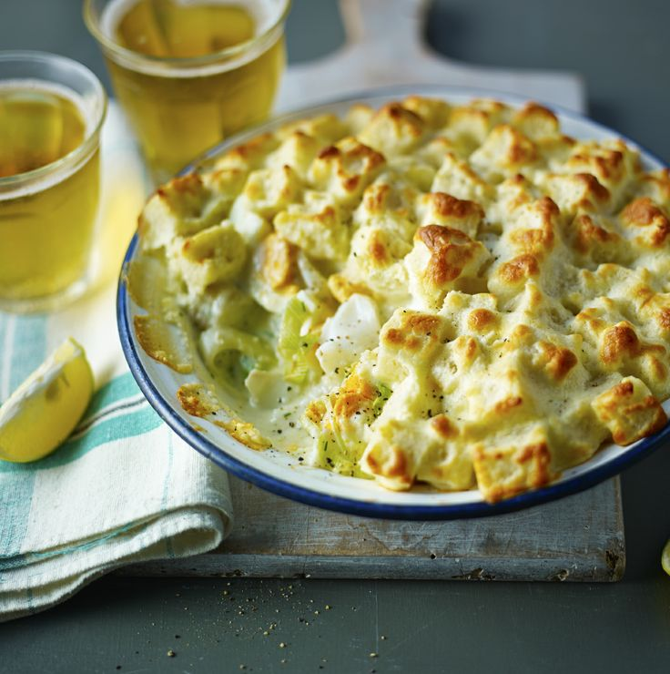 A classic pie of fish in white sauce, topped with a simple bread and soufflé style topping.