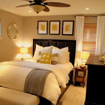 Warm, ambient light brings out the cozy feeling in this gray and yellow room. The layered window treatments offer a functional, yet aesthetically pleasing decor element. #HomeDecor #BedroomDecor #SmallBedroom #MasterBedroom