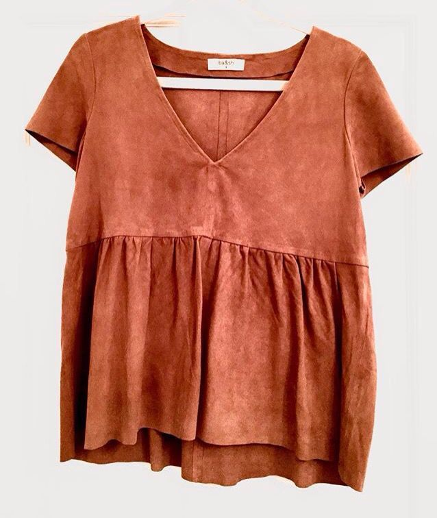 Love the top but definitely not in this color.