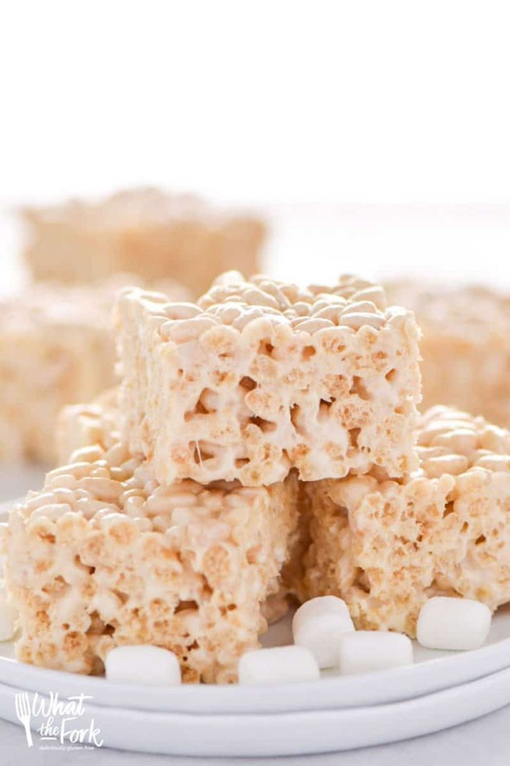 Classic Gluten Free Rice Krispies Treats - these are a crowd-pleasing favorite! They're so easy to make and have such a great gooey marshmallow to cereal ratio - they're simply addicting! Dessert recipe from @whattheforkblog | whattheforkfoodblog.com | gluten free desserts | no-bake dessert recipes | how to make rice krispie treats | gluten free no-bake recipes | easy dessert recipes | homemade rice krispies treats | marshmallow recipes | desserts for a bake sale | classic dessert recipes