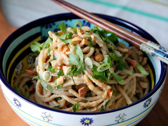 A delicious Thai-inspired cold noodle #recipe with a creamy peanut coconut dressing. Complete with brown rice #pasta!