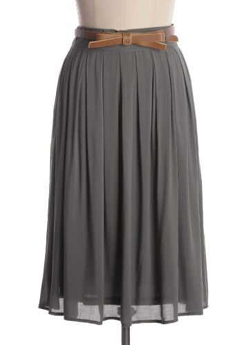 Beautiful solid gray skirt with pleats and a removable belt. Will also be available in Red, Navy, and Gray. 100% rayon. Not stretchy Lined Hand wash cold; flat dry Indie, Retro, Party, Vintage, Plus Size, Convertible, Cocktail Dresses in Canada Charming Bistro Skirt in Gray -