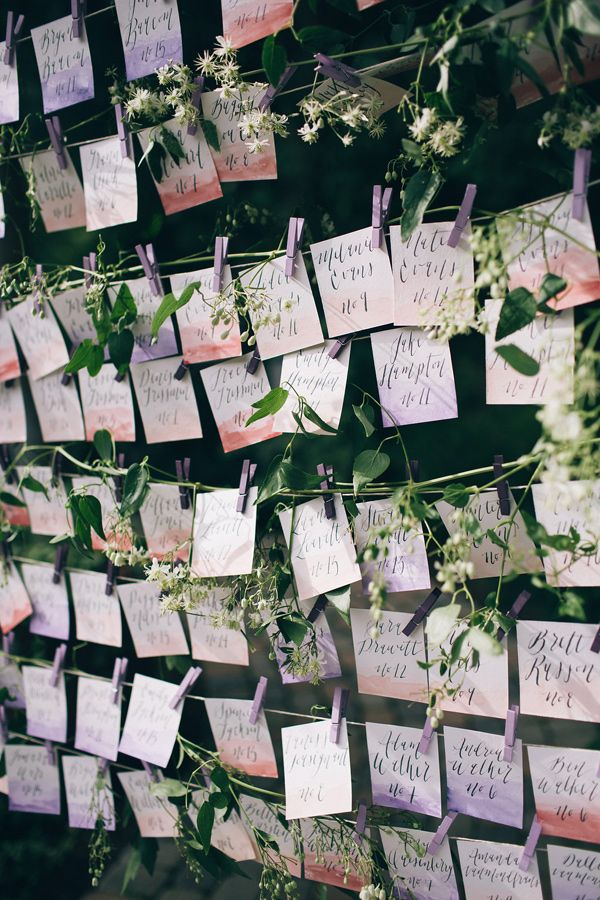 watercolor escort cards - photo by Jessica Janae Photography http://ruffledblog.com/romantic-forest-wedding