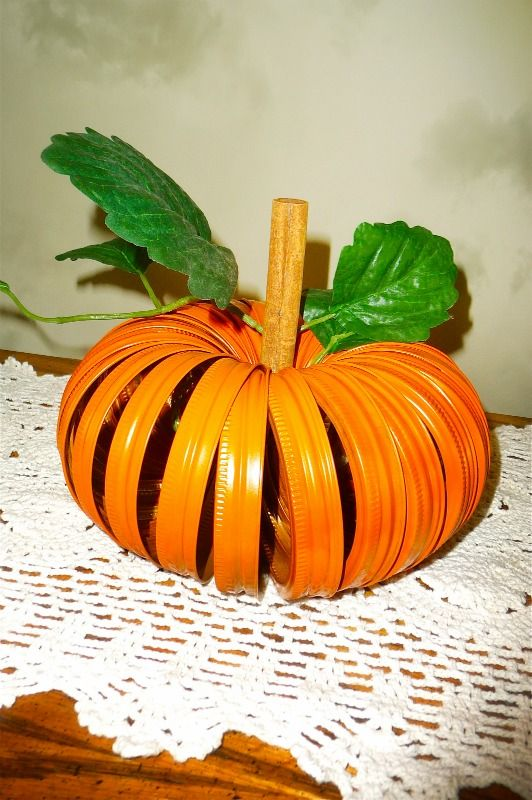 My canning jar ring pumpkin. Made with canning rings, orange paint, a piece of string, 1 cinnamon stick and a few silk leaves.