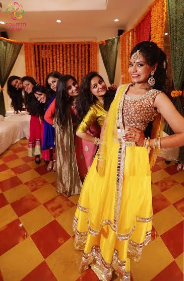 Indian Bride With Her Bridesmaids Yellow Lehenga And Colourful Bridesmaid