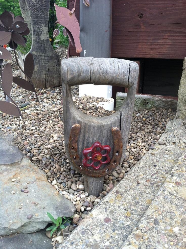 Flower bed decoration- old shovel handle with horseshoe