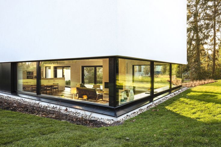 Completed in 2015 in Belgium. Images by Nathalie Van Eygen           . This private commission for a single family home is located in a wooded residential area in Belgium.The house is a response to strict legislations on...