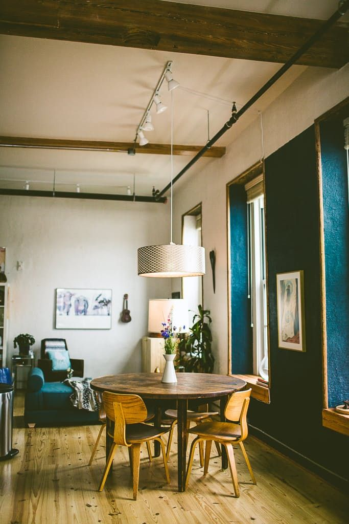 """You can see their biggest indulgence in the dining room: """"We bought eight vintage Thonet dining chairs on craigslist back when we were in a studio apartment without a dining table. It was a furniture jungle but I have no regrets."""""""