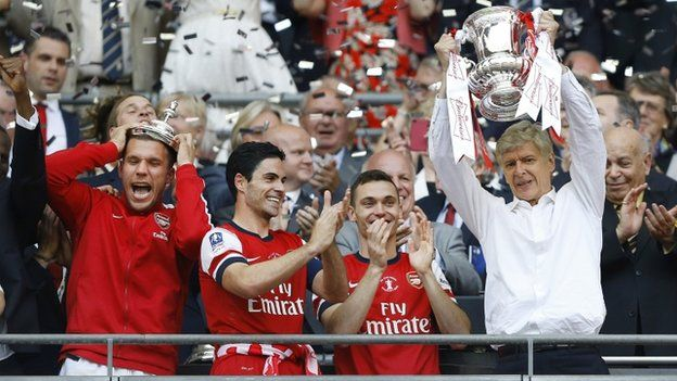 Arsenal managerArsene Wenger lifts the FA Cup. It was a long time coming for some silverware at Arsenal. They had to work for it after falling two goals down within the opening 10 minutes of the 2014 FA Cup played at Wembley.