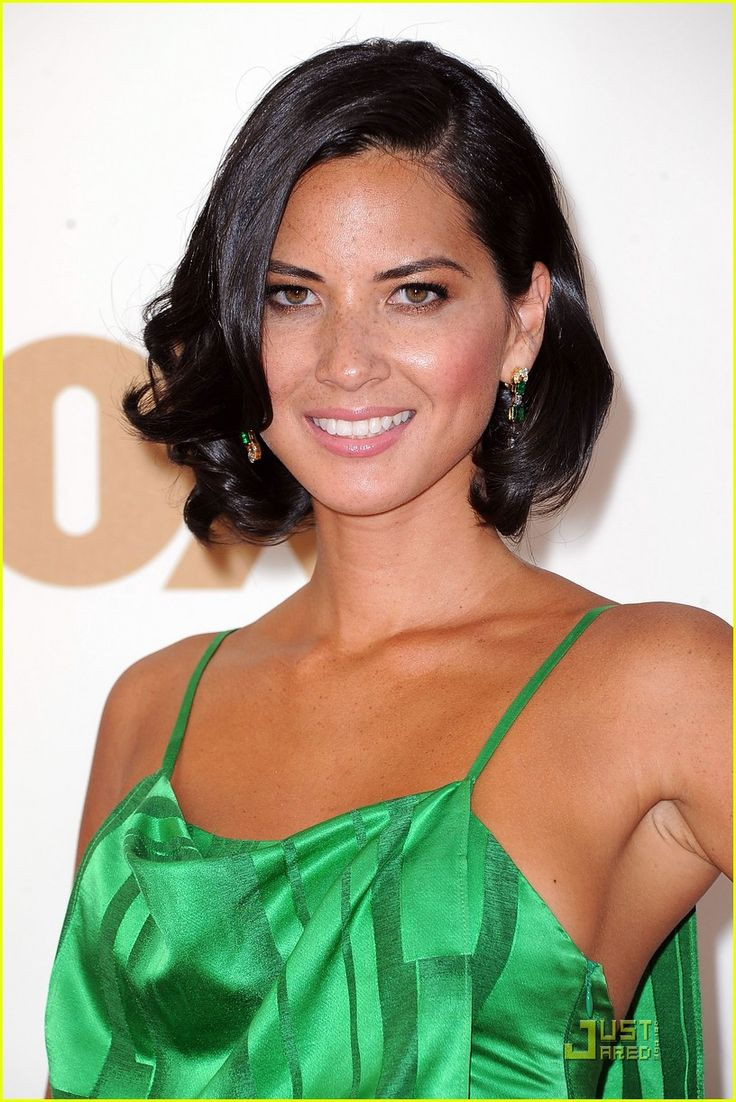 Actress Olivia Munn arrives at the 63rd Annual Primetime Emmy Awards held at Nokia Theatre L.A. LIVE on September 18, 2011 in Los Angeles, California. Description from zimbio.com. I searched for this on bing.com/images
