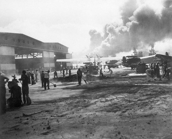 In this photo provided by the U.S. Navy, hanger No. 6 and the warm-up apron of the air station landing strip on Ford Island in Pearl Harbor, Hawaii shown during the attack, Dec. 7, 1941. (AP Photo/U.S. Navy)