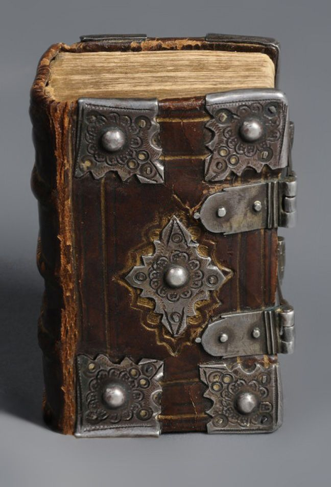 Early pocket-sized Bible with silver clasps and mounts