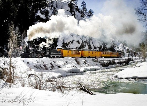 What better way to experience the majesty and grandeur of the San Juan Mountains in southwestern Colorado than by narrow gauge railroad! The Durango & Silverton Narrow Gauge Railroad line runs between the old mining towns of Durango and Silverton, Colorado. The tracks run along the steep sides of a mountain high above the Animas River. Railroad tracks are normally 4 feet 8 1/2 inches wide, but because the engineers had so little room to build, the Durango-Silverton