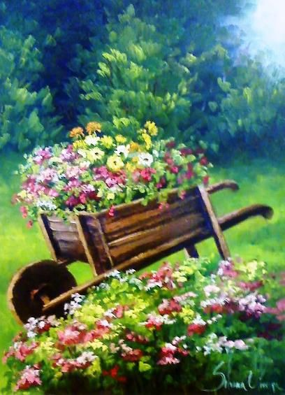 Gardens:  #Garden wheelbarrow filled with #flowers, Silvana Oliveira.
