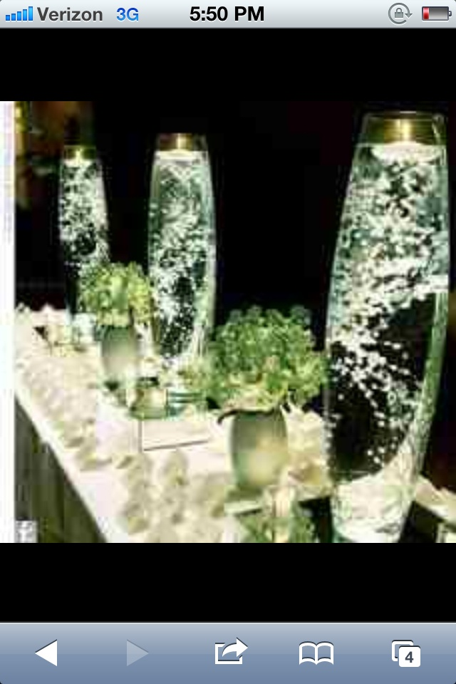 Love these Baby's breath center pieces for the sides of the table!