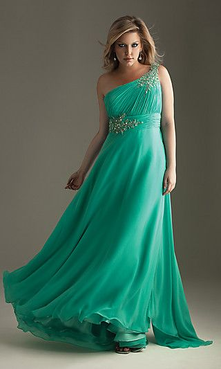 Beautiful aqua colour and the dress reminds me of a waterfall with the way it's flowing.