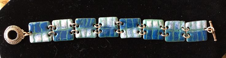 "Torch fired enamel on copper using the ""sgraffito"" technique.    ""Ice"""