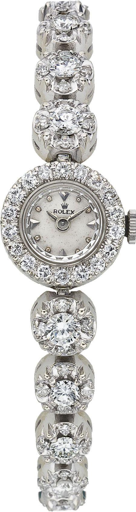 ♥••*´¨`*•.☆• вeaυтιғυl♥••*´¨`*•.☆• Rolex Lady's Diamond, White Gold Integral Bracelet Wristwatch, circa 1950.