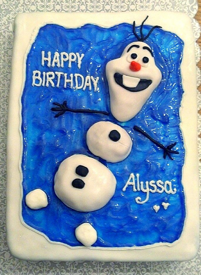 Olaf from Disney's Frozen. I really enjoyed making this one. The cake is strawberry and the Olaf character is made from cake pop filling covered in fondant.