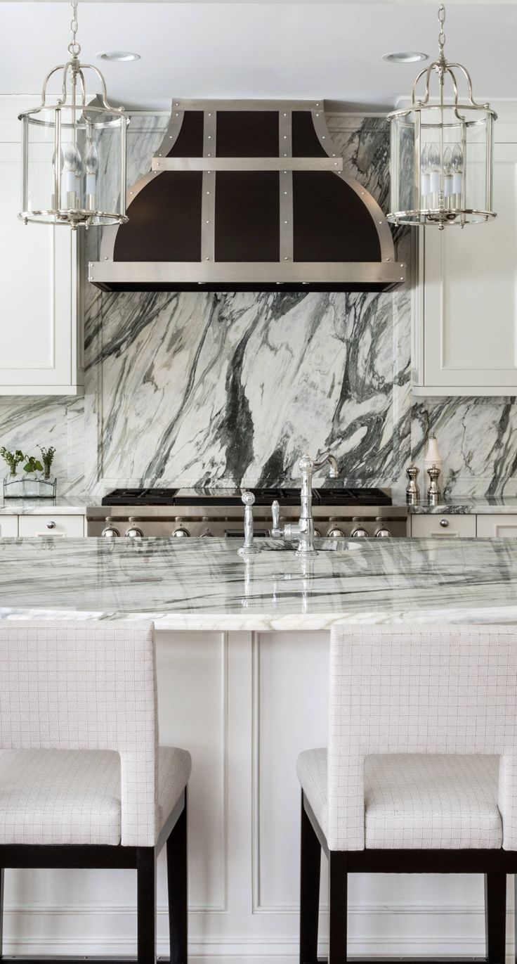 Modern kitchen with snow white quartz counter long peninsula and white - Kitchen