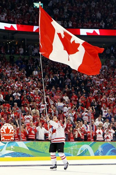 """Sidney Crosby carrying flag after his """"Golden Goal"""""""