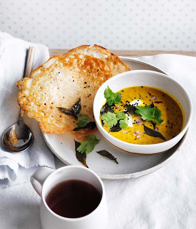 Dosas with coconut lentil curry recipe - For dosas, rinse and drain dhal and rice, then soak together in a bowl of water overnight.