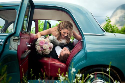 #wedding photo of the bride and groom having a good time in the backseat of a #car