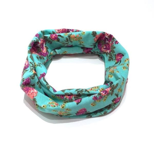 This pretty turquoise floral child scarf is perfect for any little girl. The scarf loops around twice just like an infinity scarf. It's trendy and stylish. The scarf is also functional! It will keep your babe warm during those chilly days and for your wee ones it's great for catching drool. Our scarves also make a great gift! A must have for any child's wardrobe.