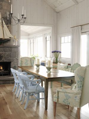 Designer Sarah Richardson, from HGTV's Sarah's House, used a wide-stripe fabric from Schumacher, aptly named Summerside, on the back of the armchairs in the lovely white dining room of her summer cottage.