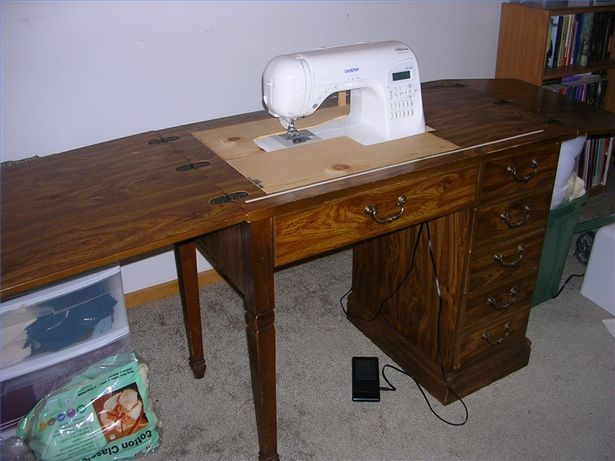 Need a sewing table for your new electronic sewing machine? Here is a cheap solution that works great. Purchase a sewing cabinet or table, old but sturdy, from a thrift store or garage sale and convert it to be used with your new sewing machine for under twenty bucks. This table works great for quilting!