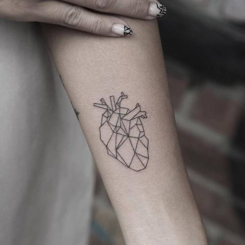 Polygonal anatomical heart tattoo on the left inner forearm....