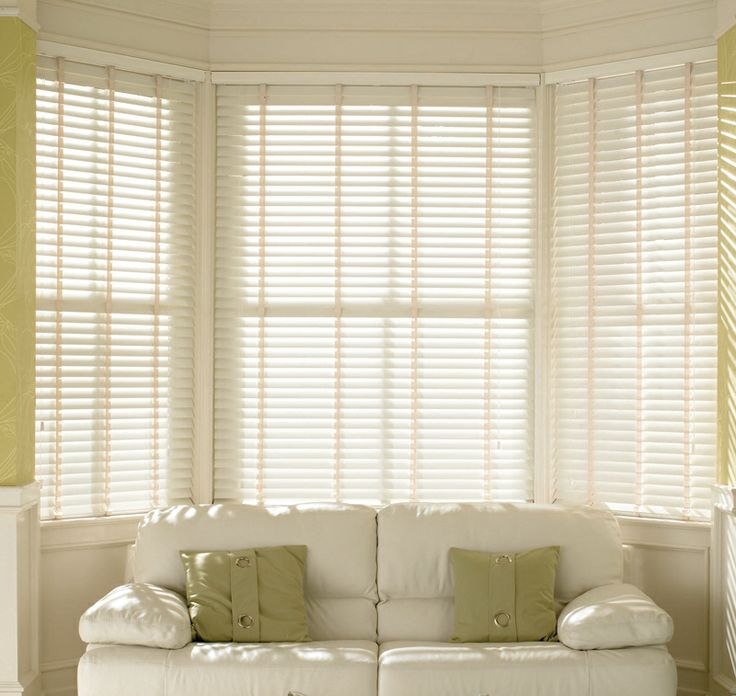 White venetian blinds for the windows - these will also help to blackout the room.