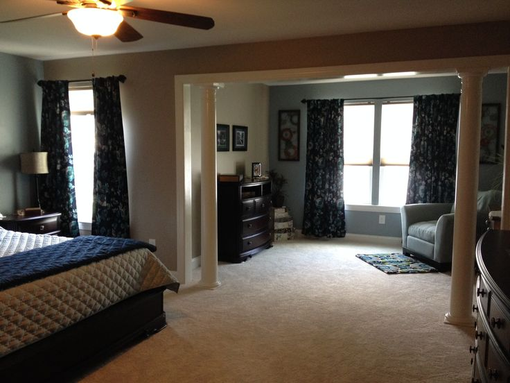 Columns In The Master Bedroom Separate The Sitting Area From The Sleeping Area And Provide A