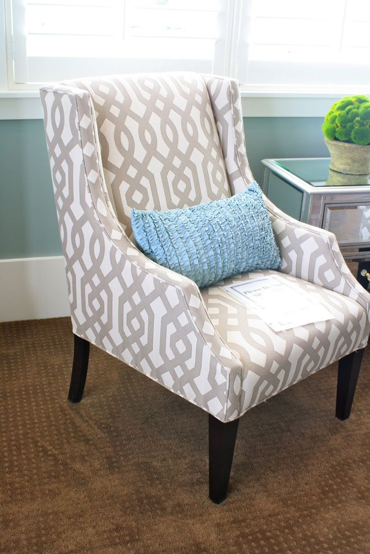 Colorful pillow on a patterned chair ~