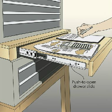 Drawer in between metal stacked tool boxes to act as a desk.
