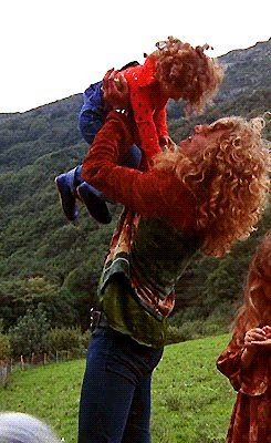 Robert Plant holding his now late son Karac Pendragon....daughter Carmen is off to the right side.