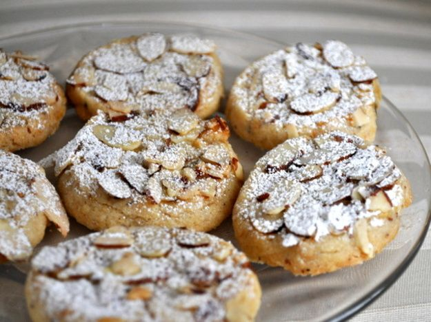 These slightly chewy Italian cookies have ground toasted almonds and blood orange zest in the base. They're dipped in egg whites and topped with slivered almonds, then coated in a dusting of confectioners sugar. A nice accompaniment to tea.