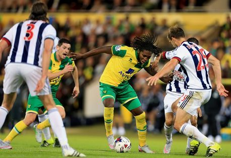 West Bromwich Albion's Craig Dawson closes down Dieumerci Mbokani of Norwich City