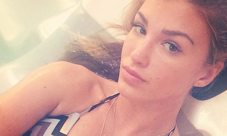 Amy Willerton can't resist posing for a VERY steamy hot-tub selfie http://dailym.ai/1mS99FI