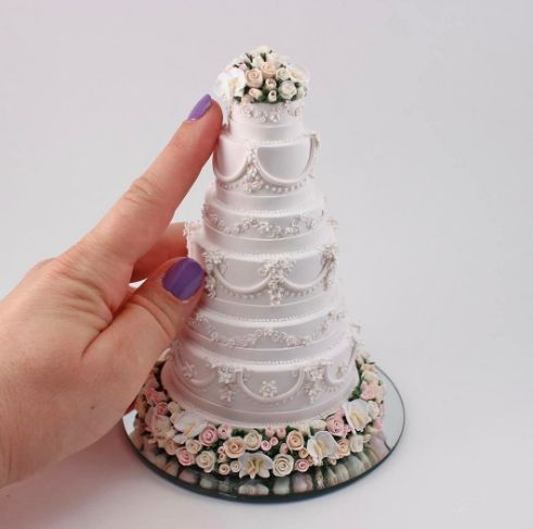 Introducing miniature wedding cakes. They're tiny ornamental versions of your wedding cakes that are hand-crafted out of polymer clay, with added chalk pastels, acrylic paint, silver leaf and jewellery wire for design.