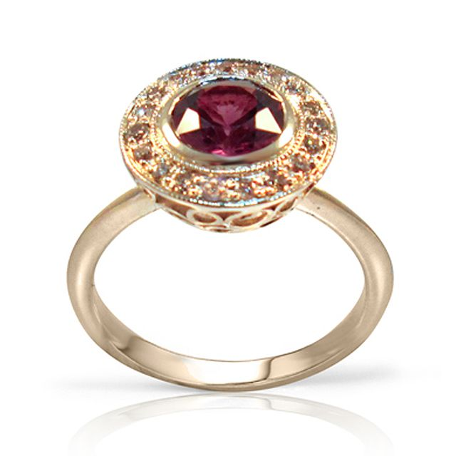 Wine Red Sapphire and Diamond Ring      0.75 ct wine red sapphire with champagne diamondsStarting from $2500