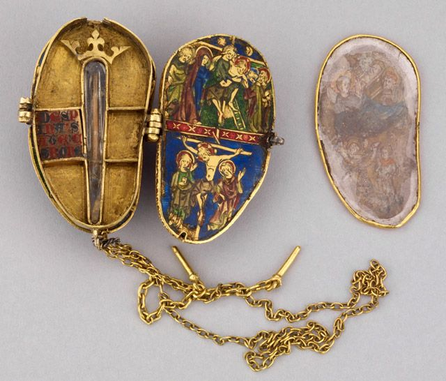 Reliquary Pendant for the Holy Thorn - Treasures of Heaven  Culture: French (Paris)Date: ca. 1340Material: Gold, enamel (basse-taille), amethyst, rock crystal, vellum, thornDimensions: 4 × 2.65 × 2.5 cm