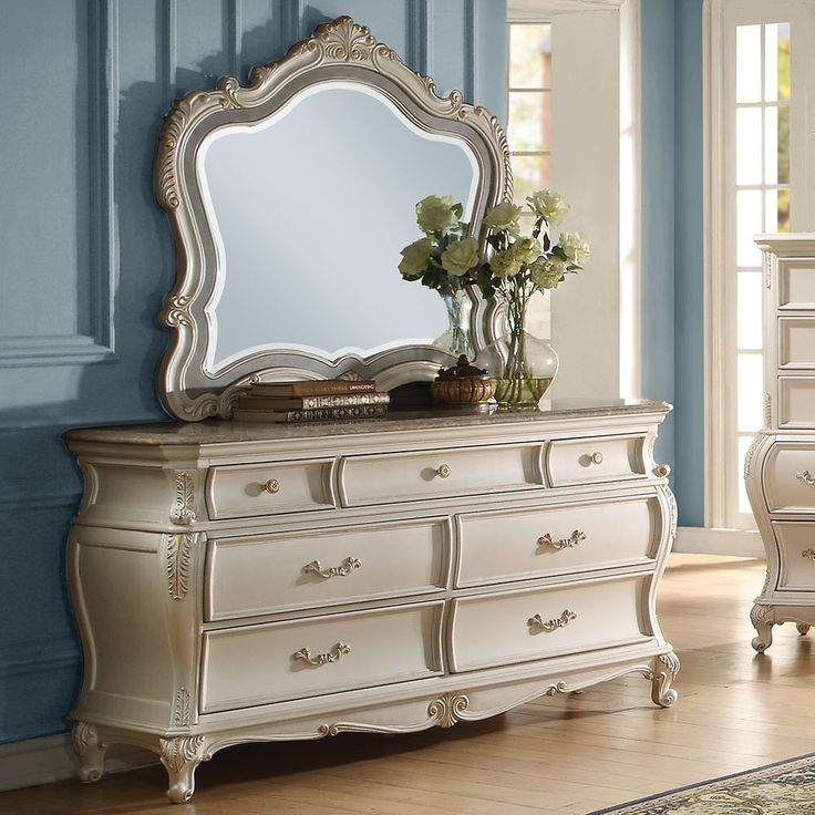 Chantelle Pearl White Dresser 23545 Description : Designed exclusively for ACME, the Chantelle bedroom collection is filled with romantic wonder. The French rococo button tufted headboard and footboar