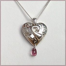 """'I am BEAUTIFUL' pendant - the ideal gift for the person who has discovered the inner beauty within herself  - yourself, or someone else.  A lovely and lively sterling silver heart ribbon pendant with intricate scrollwork and with a pink teardrop tourmaline suspended from the bottom, comes on an 18"""" s-silver chain. SPECIAL MOTHER'S DAY OFFER: $80 with free shipping for Canadian purchases. See: http://mosadijewelry.com/collections/mosadi-jewelry-pendants/products/i-am-beautiful"""