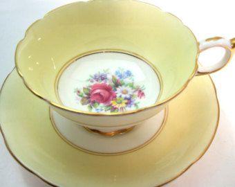 Paragon Tea Cup and Saucer, Yellow tea cup and saucer set, Antique Yellow Paragon tea cup set.
