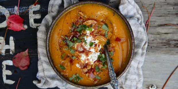 Pumpkin soup topped with oregano, natural yoghurt and bacon crumbs. Photo / Eleanor Ozich